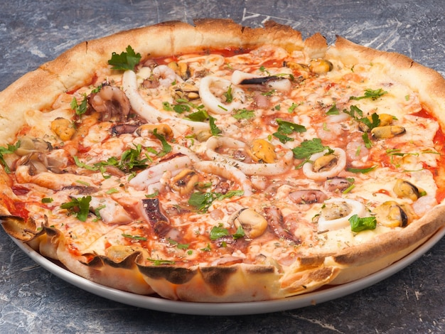 Tasty pizza with seafood shrimp squid mussels octopus