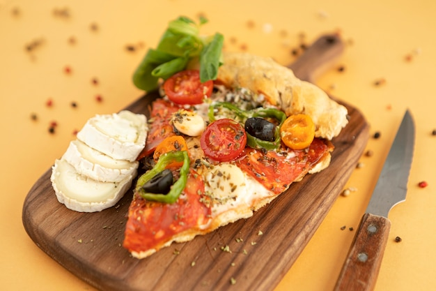 Tasty pizza on wooden board