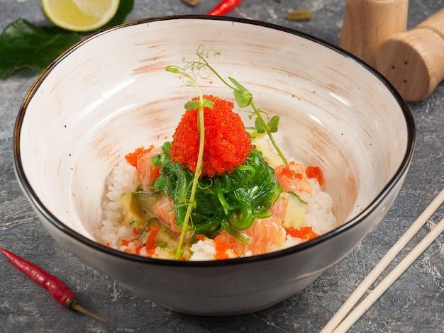 Tasty poke with salmon in mango sauce