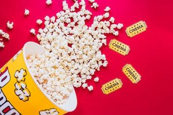 Tasty popcorn on red