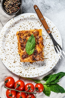 Tasty portion of italian meat lasagna with melted mozzarella