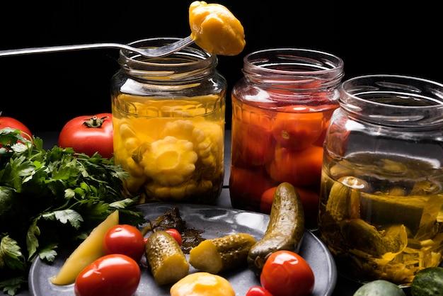 Tasty preserved vegetables on plate