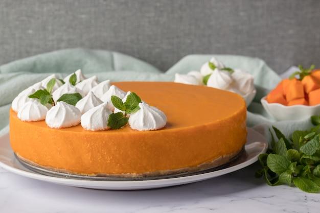 Tasty pumpkin cheesecake on marble table