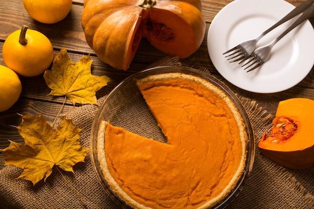 Tasty pumpkin pie on background