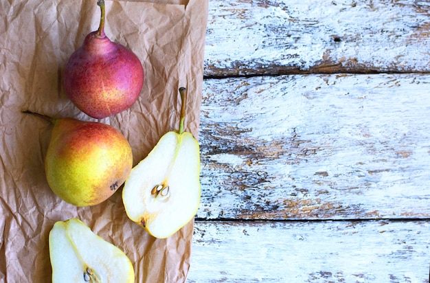 Tasty ripy juicy colorful juicy pears on wooden background