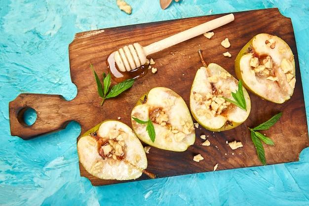 Tasty roast pears with honey and walnuts