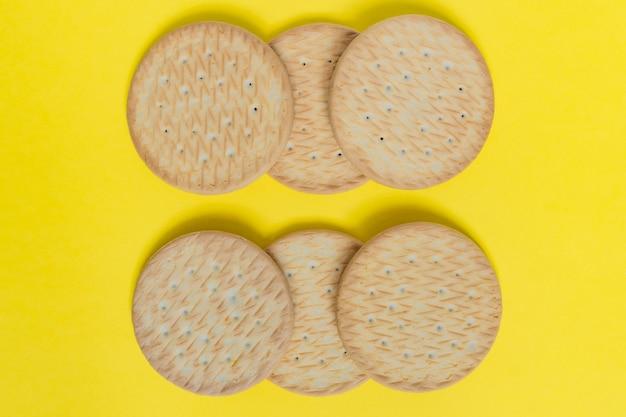 Tasty round cookies on yellow