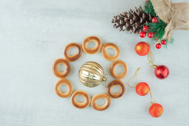 Tasty round sweet cookies with christmas balls on white backround. high quality photo