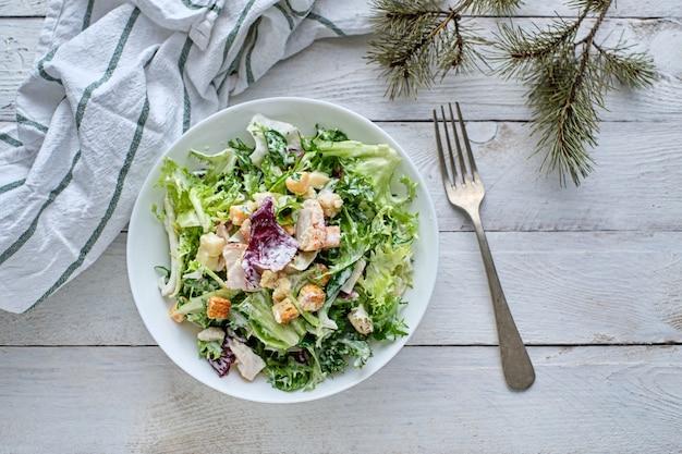 Tasty rustic tabletop cesar salad top view
