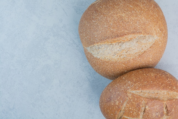 Tasty rye buns on marble background. high quality photo