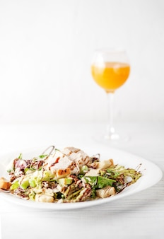 Tasty salad with cucumber and chicken.