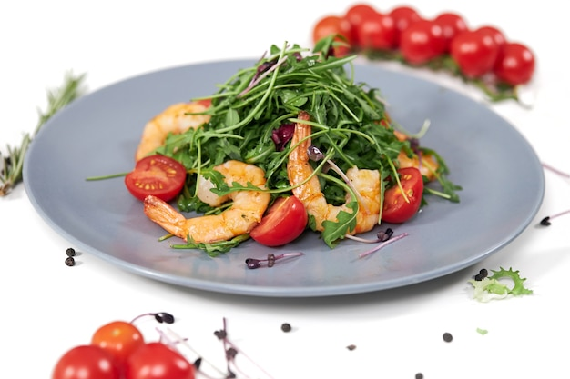 Tasty salad with juicy shrimpstomatoes and fresh arugula