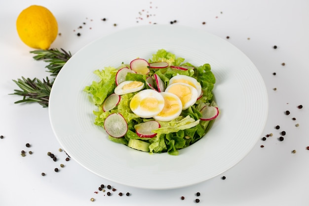 Tasty salad with lettuce radish and eggs
