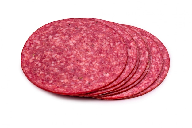 Tasty salami slices isolated on white
