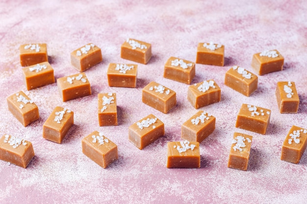 Tasty salty caramel fudge candies with sea salt, top view