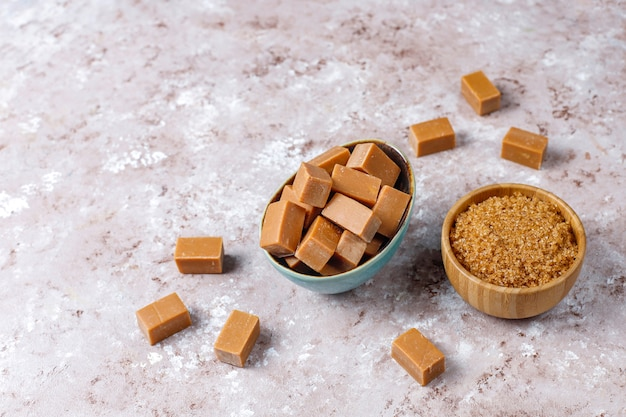 Tasty salty caramel fudge candies with sea salt,top view