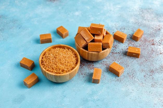 Tasty salty caramel fudge candies with sea salt,top view