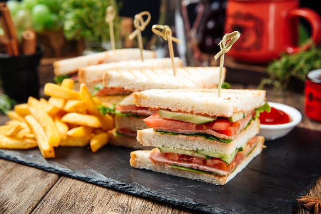 Tasty sandwiches with ham and vegetables