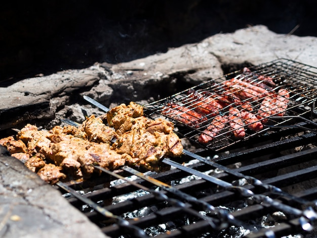 Tasty shish kebab and steaks on grill