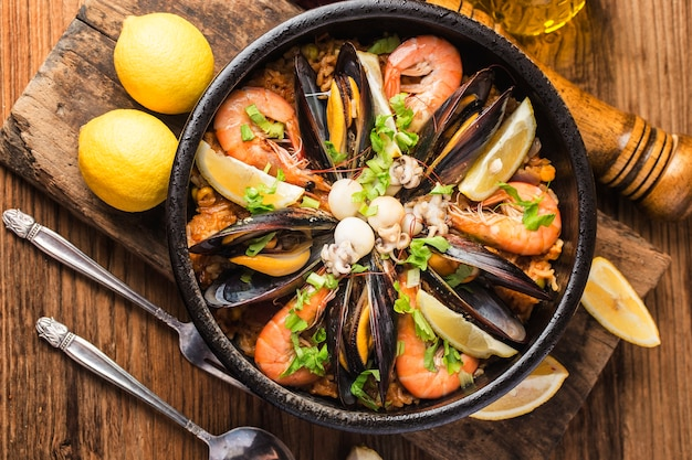 Tasty spanish paella with seafood .