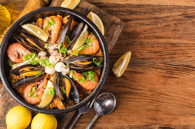 Tasty spanish paella with seafood . Free Photo