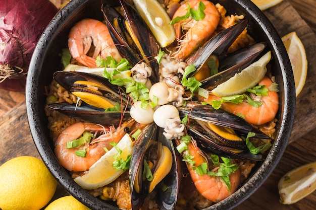 Tasty spanish paella with seafood . Free Photo