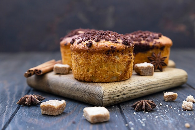 Tasty spicy muffins with chocolate streusel and cinnamon and anise star