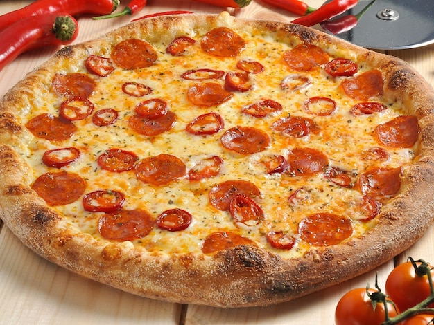 Tasty spicy pizza with chorizo hot pepper and cheese with mold