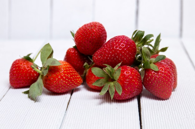 Tasty strawberries on white background
