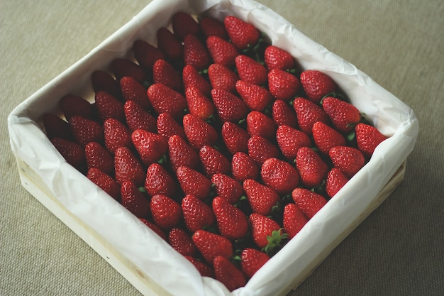 Tasty strawberries in a white box