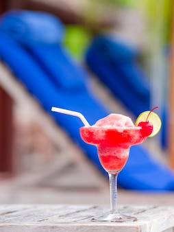 Tasty strawberry margarita swimming pool