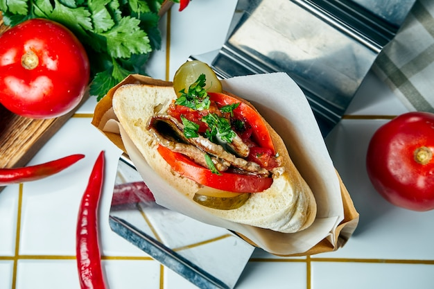 Tasty street food - pita with tomatoes, cucumbers, veal steak on a white table. greek cuisine. view.