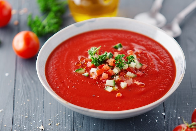 Tasty summer tomato soup served in bowl