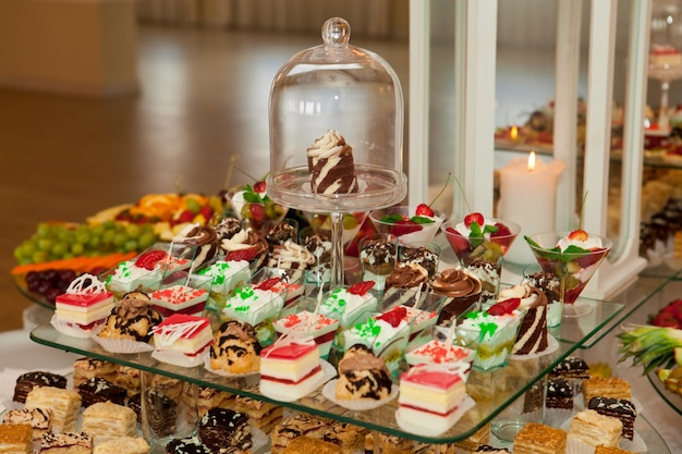 Tasty and sweet cakes on wedding banquet