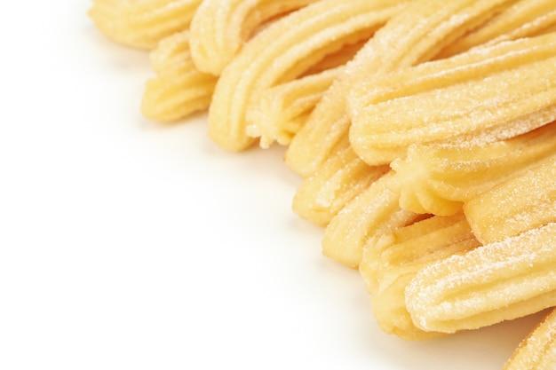 Вкусные сладкие чуррос на белом фоне