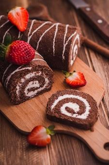 Tasty sweet dessert on cutting board
