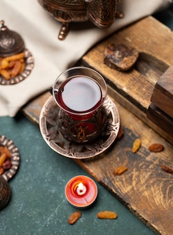 Tasty tea and snack with wooden background