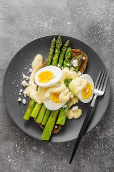 Tasty toast with asparagus, eggs and sauce