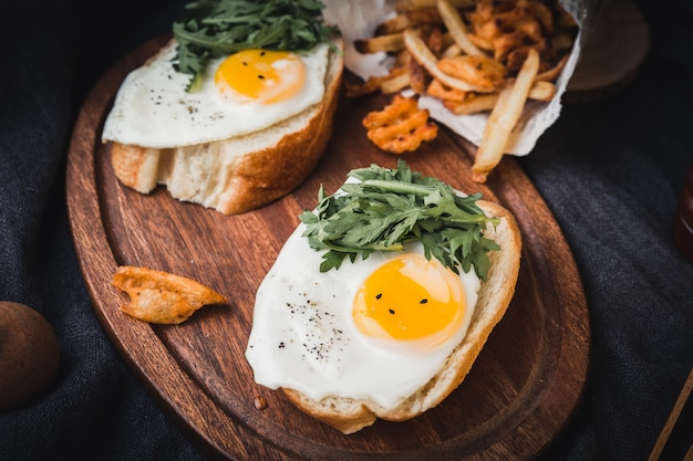 Tasty toasts with fried eggs
