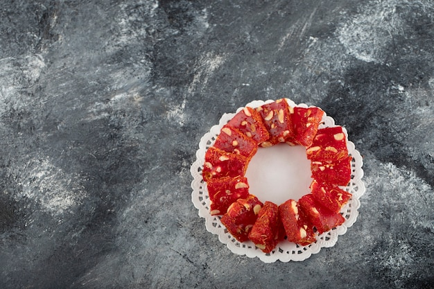Tasty turkish delight on a marble surface.