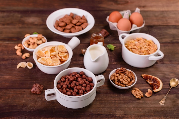 Tasty and useful breakfast with flakes, milk, nuts and dried fruits