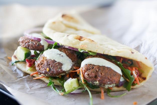 Tasty vegan falafel wrap shot with selective focus