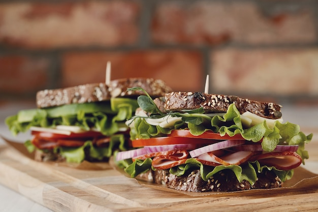 Tasty vegan sandwich over wooden table