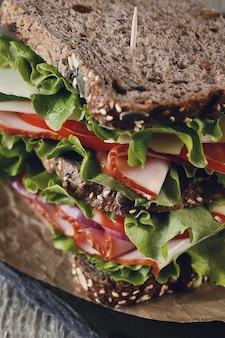 Tasty vegan sandwich over wooden table