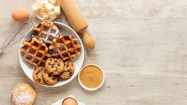 Tasty waffles and cookies with copy space