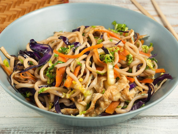 Tasty wheat noodles with vegetables and omelet. asian cuisine