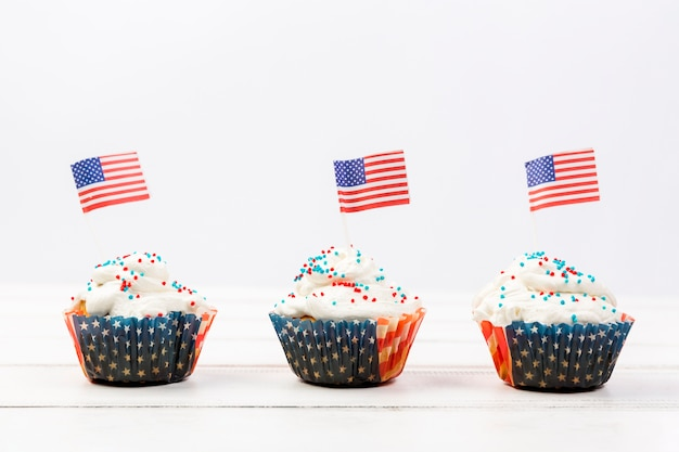Tasty whipped cream cupcakes with american flags