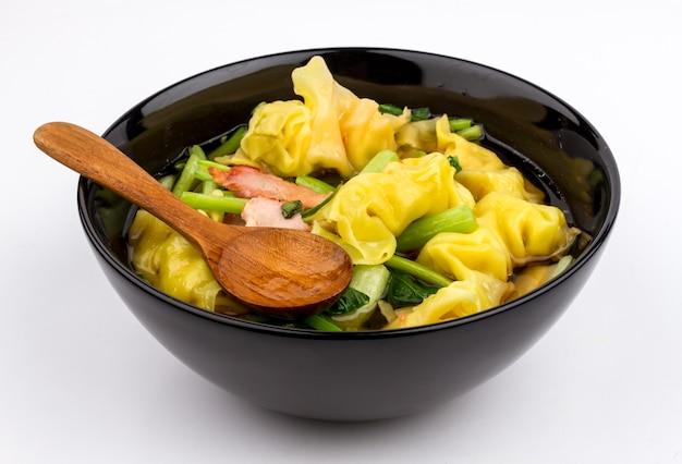 Tasty wonton soup on white background