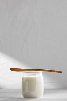 Tasty yogurt and wooden spoon