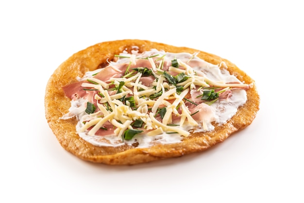 Tastyful fried langos served with cheese, cream, prosciutto, garlic and green onion.